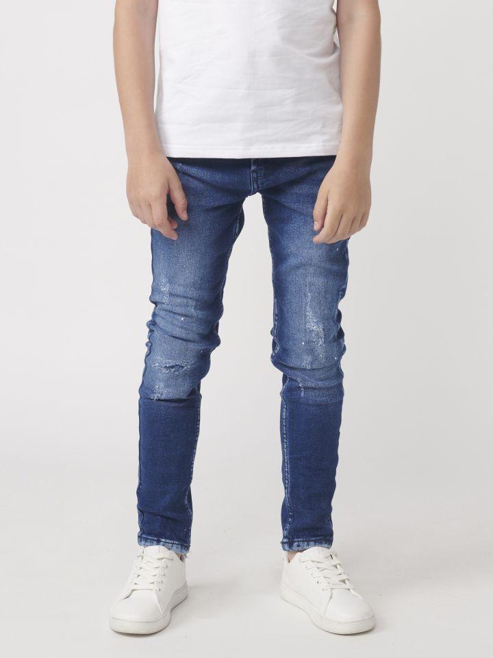 ג`ינס סקיני עם קרעים