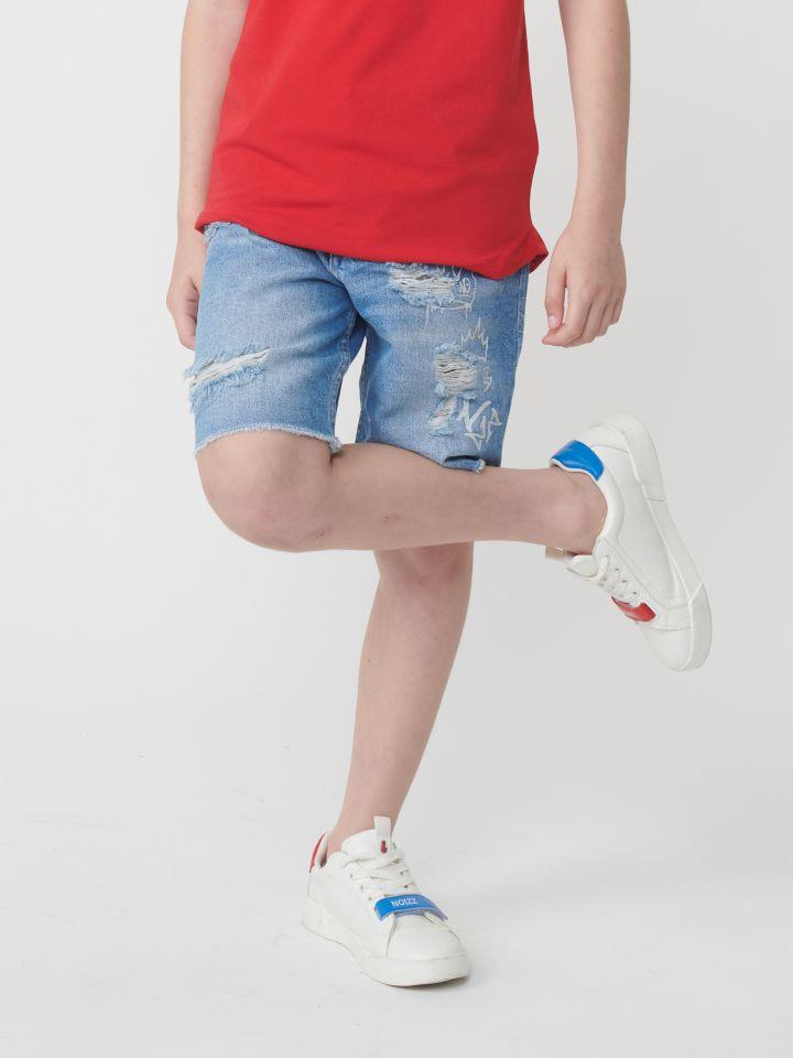 ברמודה ג`ינס בגזרת לוז עם דפוסים